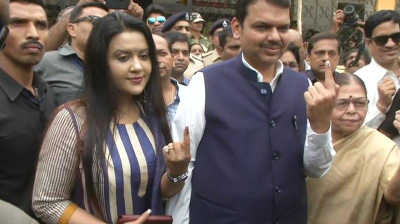 The chief minister arrived at the polling booth with his wife Amruta and mother Sarita Fadnavis at 12.20 pm. (Image: ANI twitter)