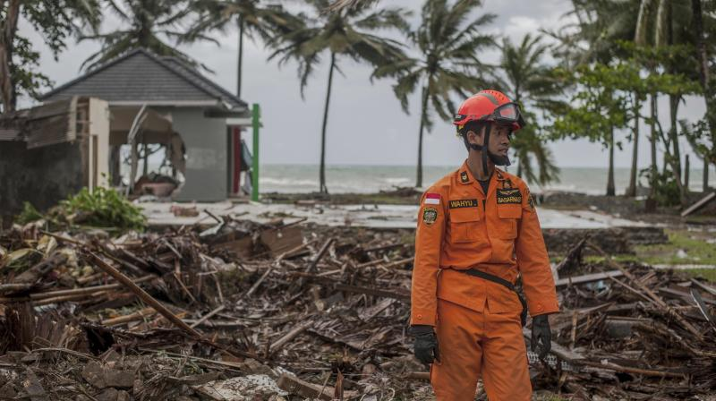 A rescuer stands amid debris at a tsunami-ravaged area in Carita, Indonesia, Sunday. (Photo: AP)
