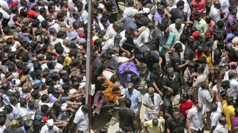 She collapsed in the queue and was shifted to the health centre at the venue. Doctors declared her dead. (Photo: AP)