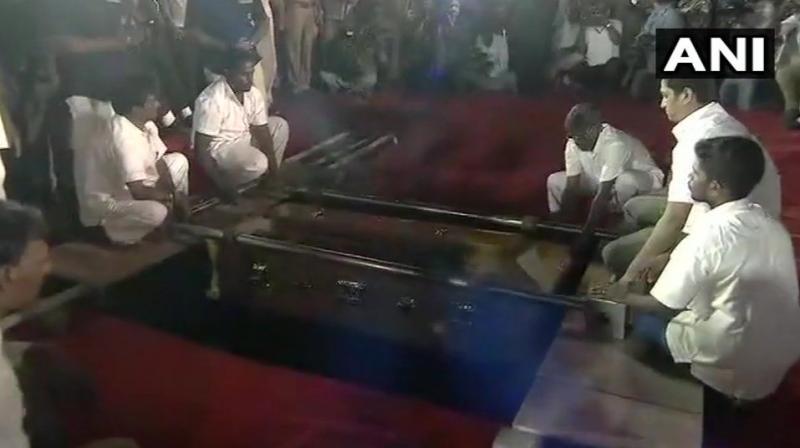 DMK chief M Karunanidhi being laid to rest at Marina Beach. (Photo: ANI)