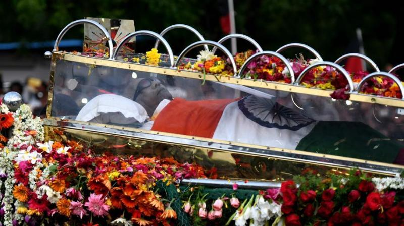 The country's high and mighty descended on the city to pay their last respects to the 'Thalaivar'. (Photo: AFP)