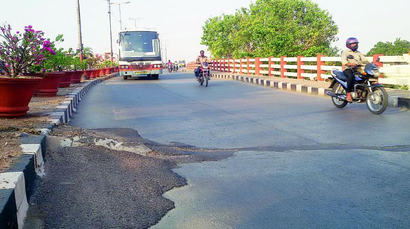 The decades-old Lalapet flyover which has many potholes. — File Photo