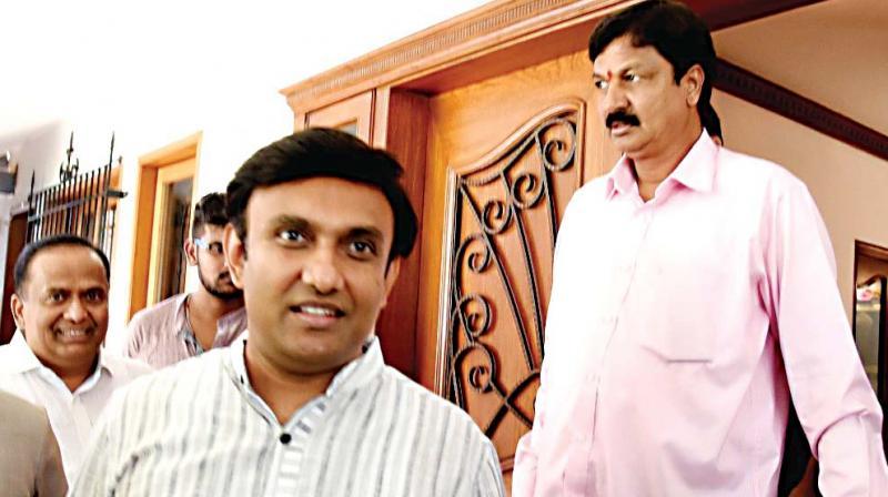 Congress rebel MLAs Sudhakar and Ramesh Jarkiholi