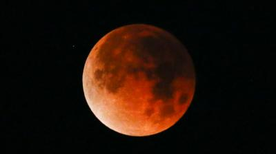 A rare celestial occurrence as a 'Super Blue Blood Moon' is seen at Santa Monica Beach in Santa Monica, Calf. The moon is putting on a rare cosmic show. It's the first time in 35 years a blue moon has synced up with a supermoon and a total lunar eclipse. NASA is calling it a lunar trifecta: the first super blue blood moon since 1982. That combination won't happen again until 2037.