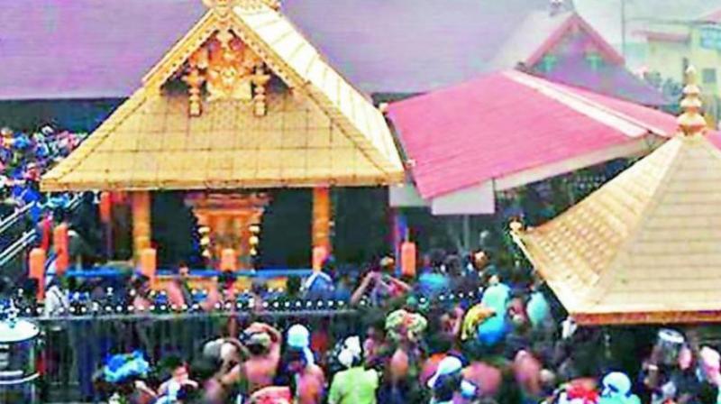 Devotees arrive at the Lord Ayyappa temple that opened on Saturday for the two-month-long Mandala-Makaravillakku pilgrimage season, in Sabarimala. (PTI)