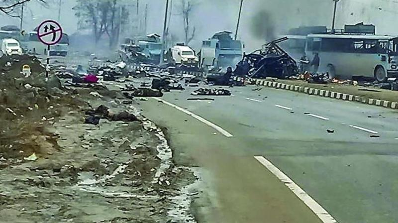 A scene of the spot after militants attacked a CRPF convoy in Goripora area of Awantipora town in Pulwama district of J&K on Thursday. At least 49 CRPF jawans were killed in the attack. (Photo: PTI)