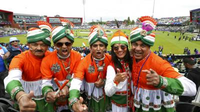 Indian fans pose for a photo ahead of the fiery India Pakistan clash (Photos: AP)