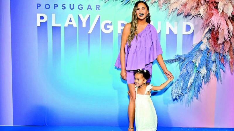 American model and author Chrissy Teigen tagged her toddler with her to the Popsugar Play/Ground event on Sunday afternoon.