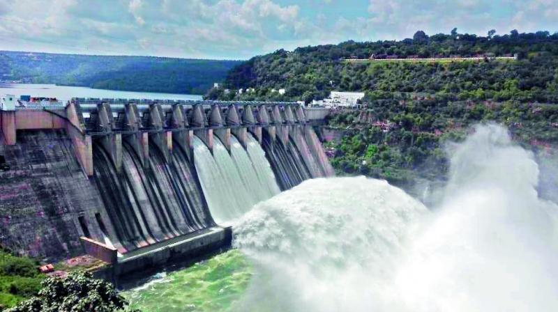 Four crest gates of Srisailam dam was opened on Sunday after water in the reservoir recorded 884.80 feet against the total reservoir height of 885 feet.
