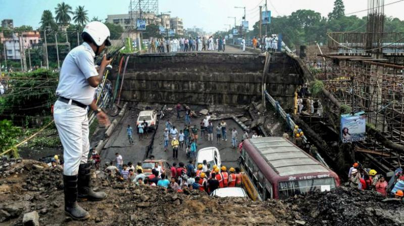 A section of over 50-year-old Majerhat Bridge on the arterial Diamond Harbour Road in south Kolkata collapsed on September 4 in which 3 people lost their lives. (Photo: File | PTI)