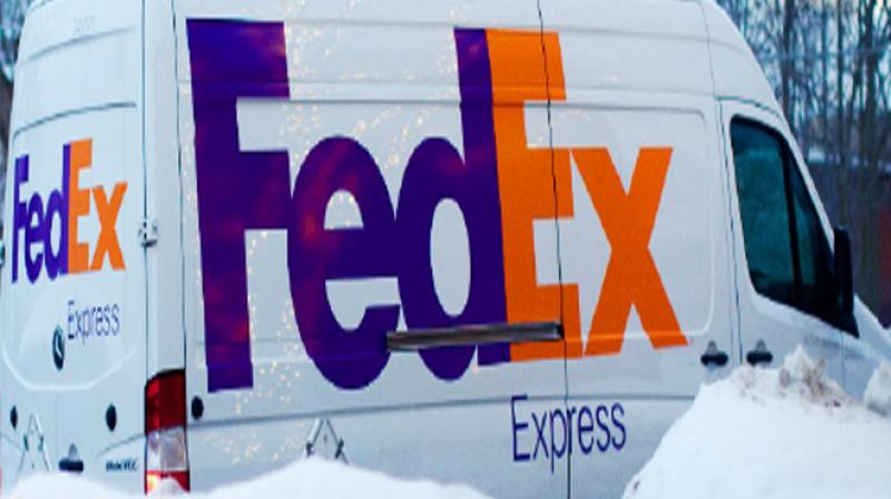 FedEx (NYSE:FDX) PT Lowered to $240.00