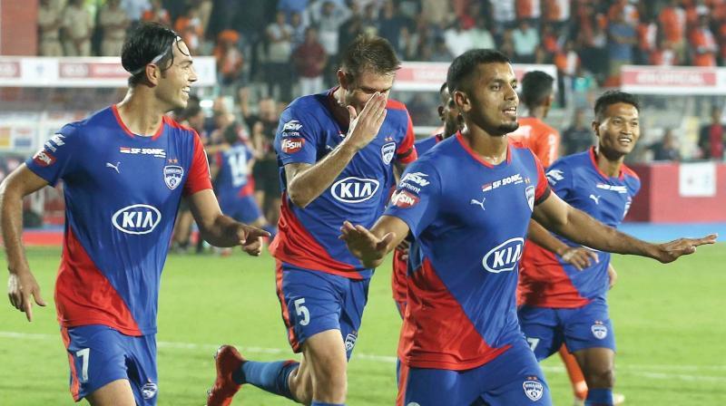 Rahul Bheke with his team mates celebrate netting the winning goal.