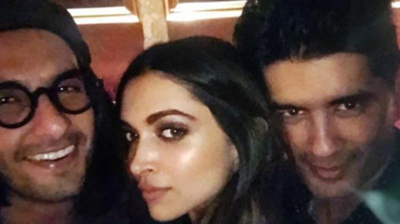 Ranveer Singh, Deepika Padukone and Manish Malhotra in the picture shared by the fashion desinger.