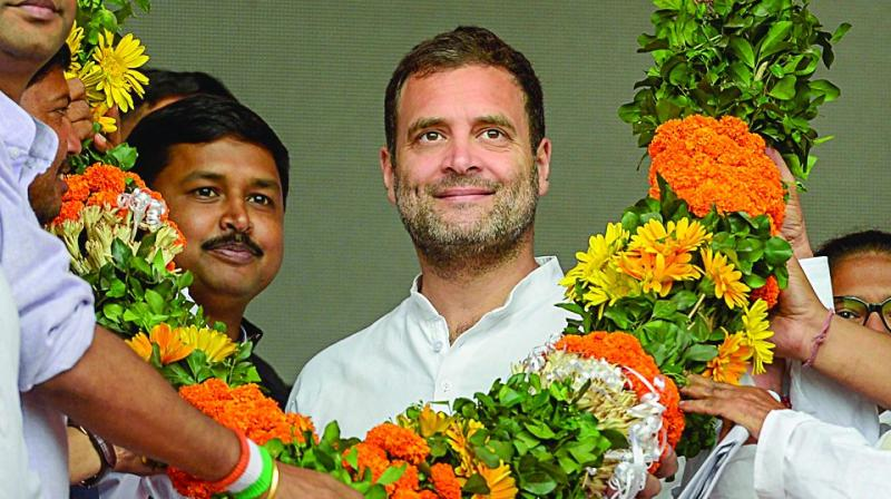 Congress president Rahul Gandhi at an election rally at Panchgram in Silchar, Assam, Tuesday. (Photo: AP)