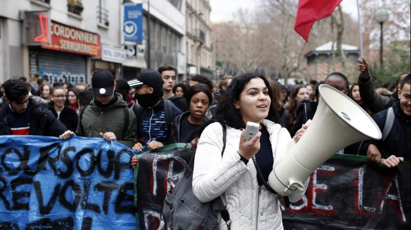 Shouts of 'Macron, resign' mingled with the tear gas near the famous Champs-Elysees avenue, the scene last Saturday of the worst rioting in Paris for decades. (Photo: AP)