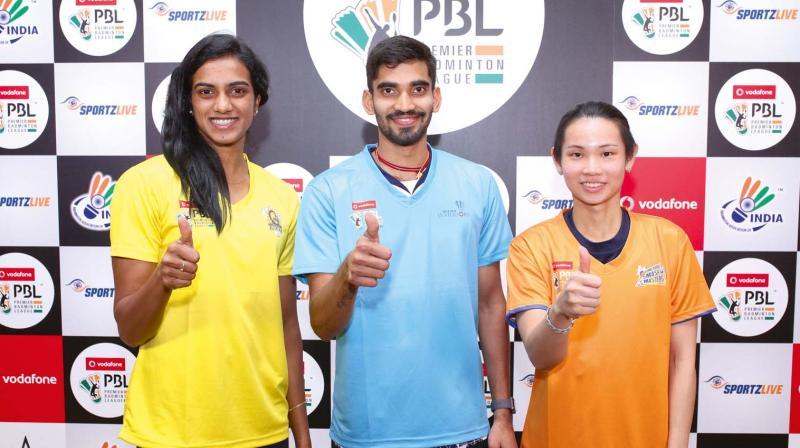 P.V. Sindhu (from left), Kidambi Srikanth and World No.1 Tai Tzu Ting pose ahead of the Dubai BWF world super series finals on Sunday.