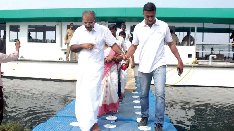 Transport Minister A.K. Sassendran comes out after the trial run of the solar ferry 'Aditya at Aroor.