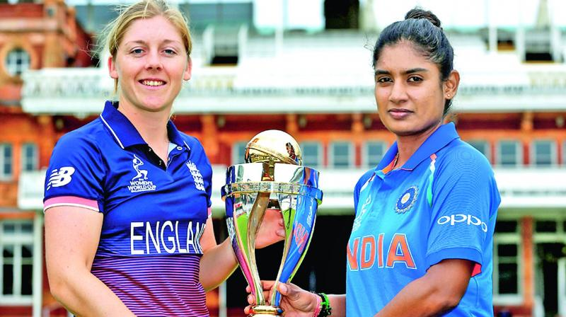 Rival captains Heather Knight (left) and India's Mithali Raj pose with the WC at Lord's on Saturday. (Photo: Agencies)