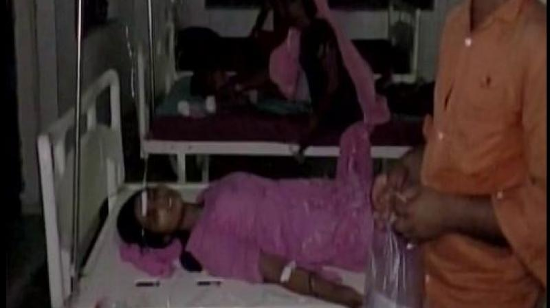 People fall ill after breaking their daily Ramzan fast at a madrassa in Harwatand village at Bahraich in UP. Photo: ANI Twitter)