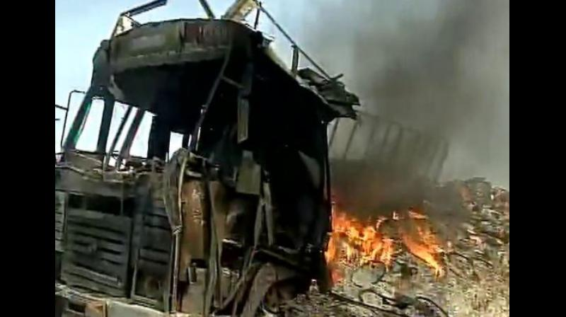 Irate farmers torch vehicles in protest in Madhya Pradesh. (Photo: ANI Twitter)