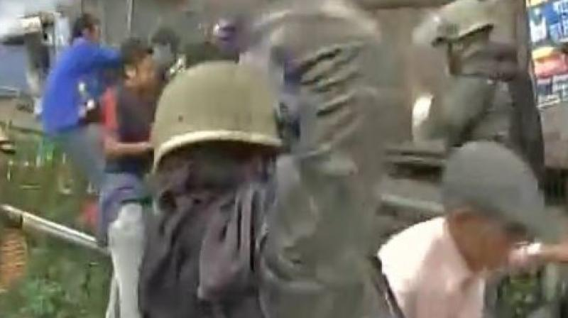 Police resort to lathi charge as GJM supporters pelt stone on forces. (Photo: ANI | Twitter)