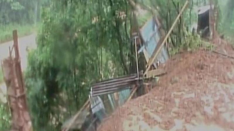 Incessant rains trigger landslide in Ri Bhoi in Meghalaya. (Photo: ANI | Twitter)