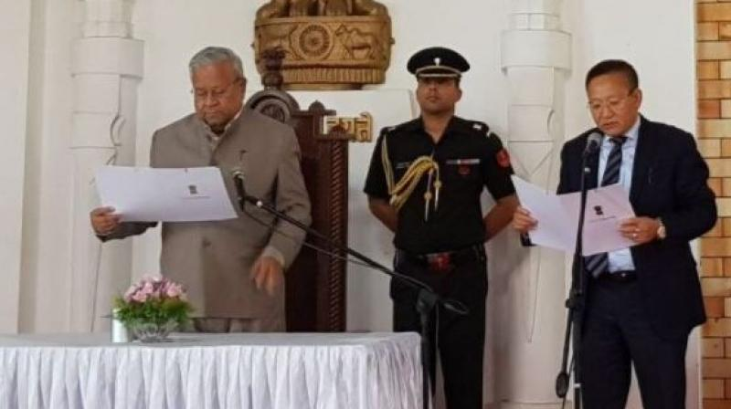 TR Zeliang sworn in as the Chief Minister of Nagaland at Darbar Hall, Raj Bhavan in Kohima. (Photo: Twitter | ANI)