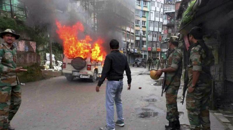 The protesters turned violent and set afire some vehicles parked nearby. (Photo: PTI | File)