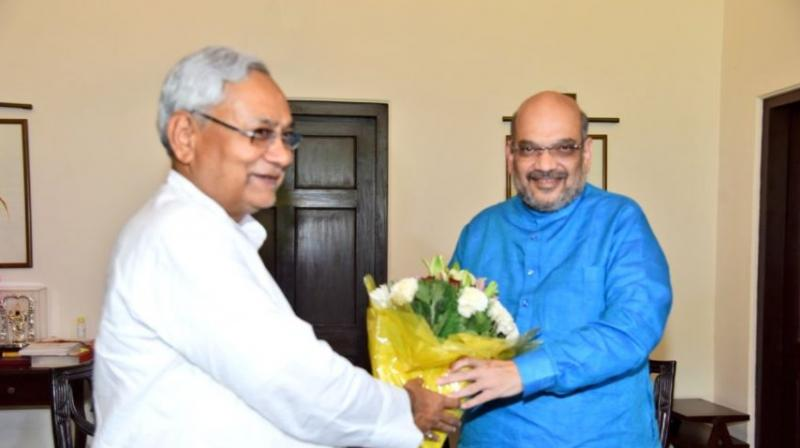 On Friday Bihar Chief Minister and JD(U) President met BJP national President Amit Shah in New Delhi. (Photo: Twitter | @AmitShah)