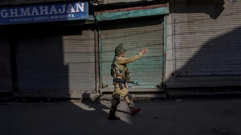 "Kashmir and parts of Chenab valley of Jammu region were shut on Saturday to protest against alleged ""devious attempts"" being made at the behest of Sangh Parivar to abrogate Article 35A and Article 370 of the Constitution. (Photo: AP)"