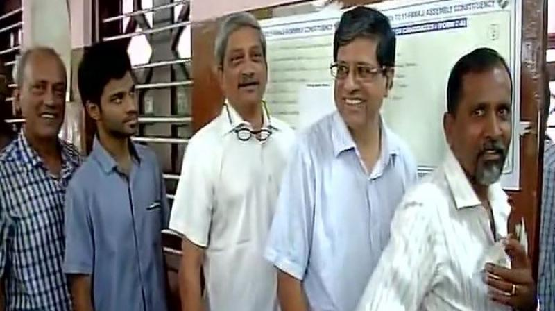 Goa Chief Minister Manohar Parrikar waits in queue to cast his vote in assembly bypoll. (Photo: ANI   Twitter)