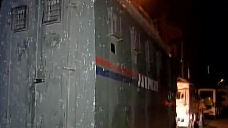 Terrorists attack a bus of security personnel at Pantha Chowk in Srinagar. (Photo: ANI | Twitter)