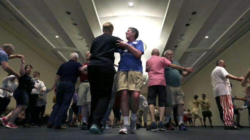 At the time, many heterosexual square dance clubs expected members to come in pairs, said Howard Richman, a member of the Times Squares, New York's LGBTQ-friendly square dance club. (Photo: AP)