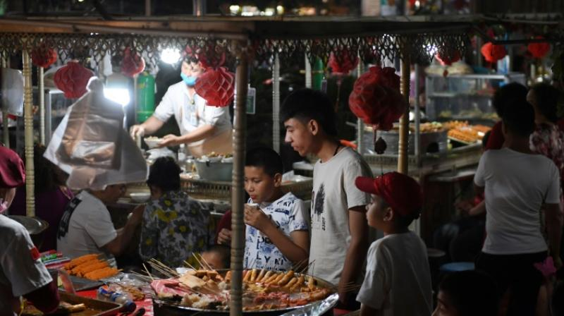 According to Communist Party mouthpiece People's Daily, the regional government offered travellers subsidies worth 500 yuan ($73) each in 2014, after tourism plunged following a deadly knife attack blamed on Xinjiang separatists in south-western China. (Photo: AFP)