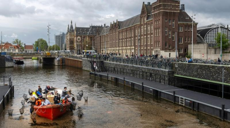 The Plastic Whale tours are part of a growing trend, with Amsterdam authorities separately launching a series of initiatives to direct tourists to alternative activities and ease the pressure on the top sites. (Photo: AFP)