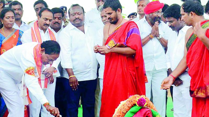 Chief Minister K. Chandrasekhar Rao lays the foundation stone for the Rajanna Sircilla district collectorate in Sircilla on Wednesday. (Photo: DC)