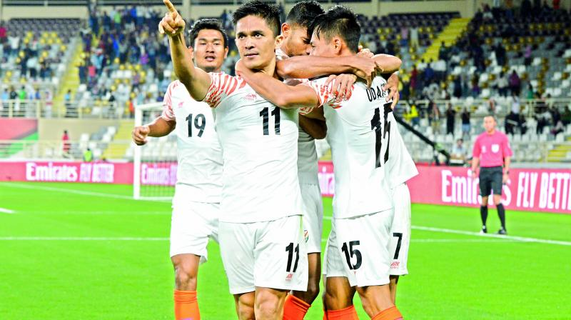 Indian forward Sunil Chhetri (11) celebrates a goal with his teammates during the AFC Asian Cup Group 'A' match against Thailand at Al Nahyan Stadium in Abu Dhabi, United Arab Emirates, on Sunday. India won 4-1.