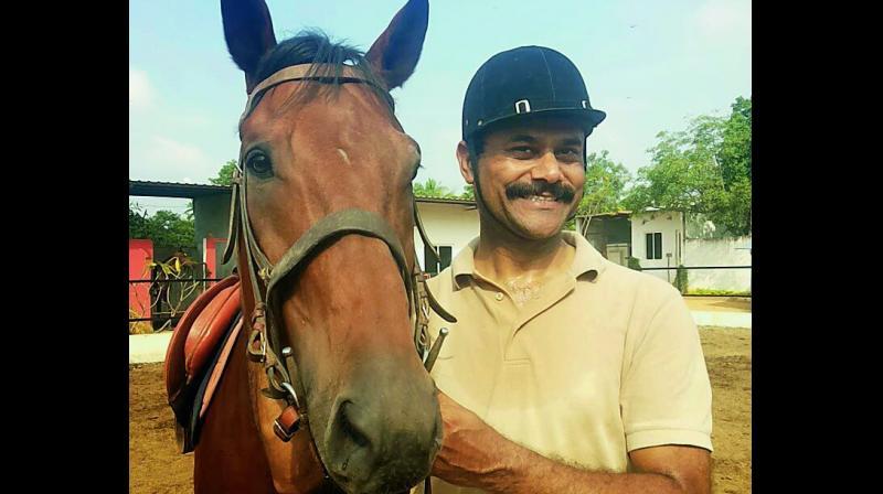 Captain Praphulla Raj Singh with his horse Prithvi
