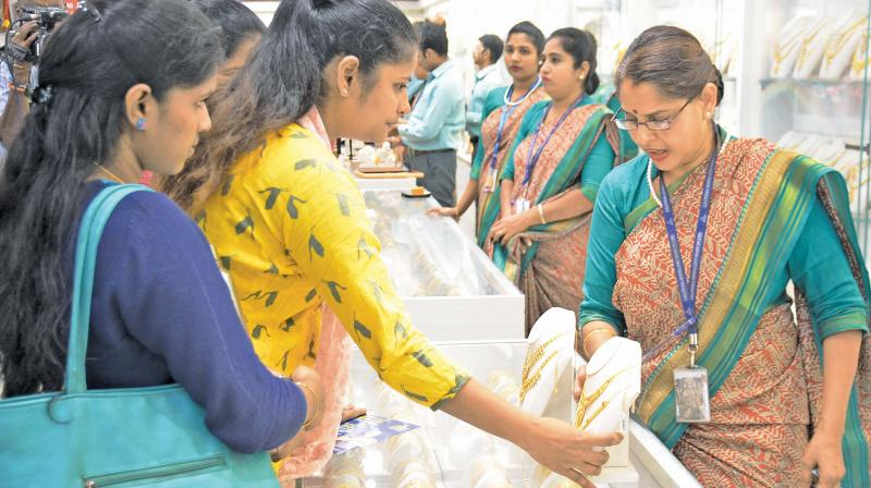 Women buy and try on jewels at a jewellery shop in T. Nagar, on Akshaya Tritiya day,  on Tuesday.  (Image DC)