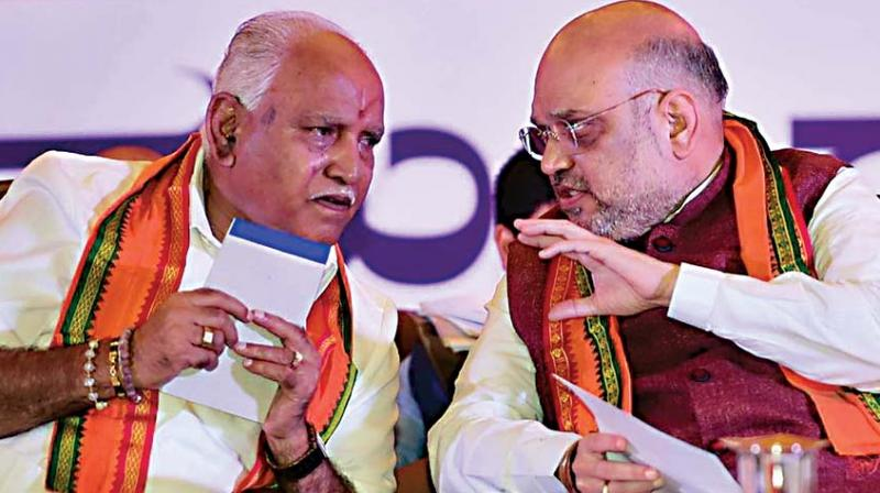 A file photo of BJP president Amit Shah with party's state unit chief B.S. Yeddyurappa