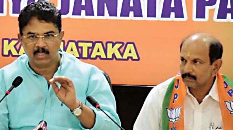A file photo of BJP leader R. Ashok with Mandya LS candidate Dr Siddaramaiah, who lost to the JD(S) candidate