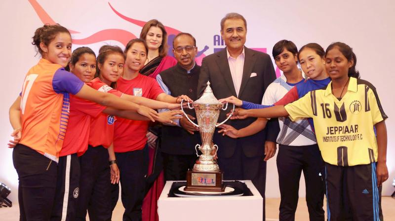The captains of the six teams of the Indian Women's League with Praful Patel and Vijay Goel. (Photo: PTI)