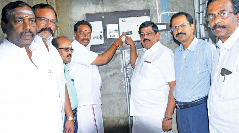 Minister Udumalai K Radhakrishnan releases water from Amaravathi dam on Friday for irrigation in Tirupur and Karur districts. (Photo: DC)