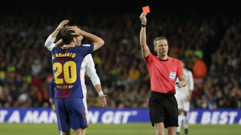 The Spain international will also be suspended for the first Liga game of next season when Barca begin their title defence. (Photo: AP)