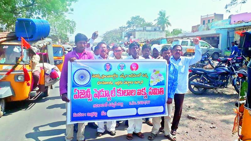 Dalits living in Agency areas take out a rally under the banner of the Agency Scheduled Kulala Ikya Samiti demanding pattas for the lands they have been cultivating in Indravelli Town on Monday. (Photo:DC)