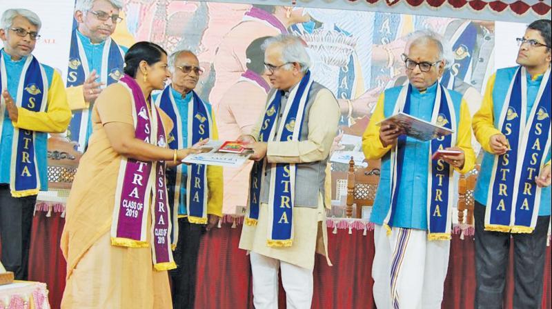 Dr C.Shekar C. Mande,secretary, DSIR, gives the degree to a candidate at Sastra varsity at Thanjavur on Sunday. (Photo: DC)