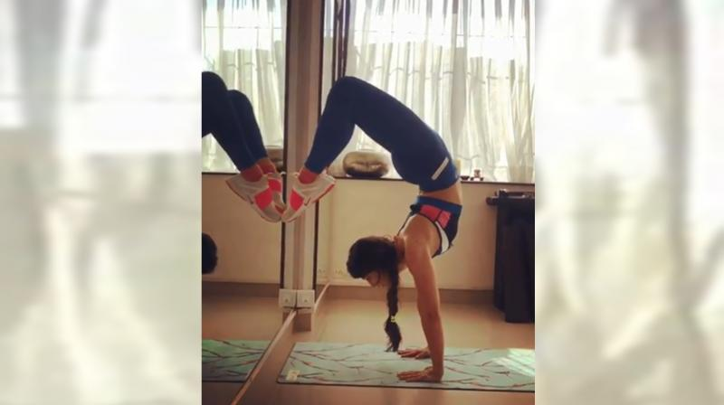 Monday motivation! 'Headstand' your day just the way Jacqueline Fernandez does it