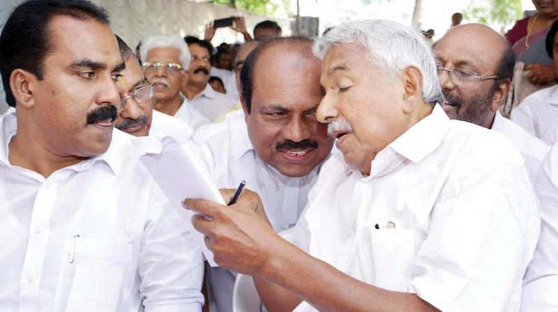 Former chief minister Oommen Chandy with Congress MLAs during the protest.