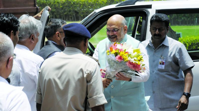 BJP president Amit Shah arrives to take charge as the Union home minister at North Block in New Delhi on Saturday. (Photo: Sondeep Shankar)