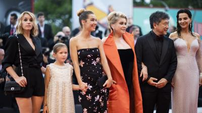 Actresses who starred in 'The Truth' are seen gracing the red carpet at Day 1 of the Venice Film Festival. (Photo: AP)